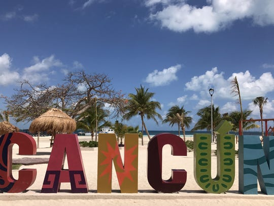 Tourist walks along the beach in Cancun, Quintana Roo,