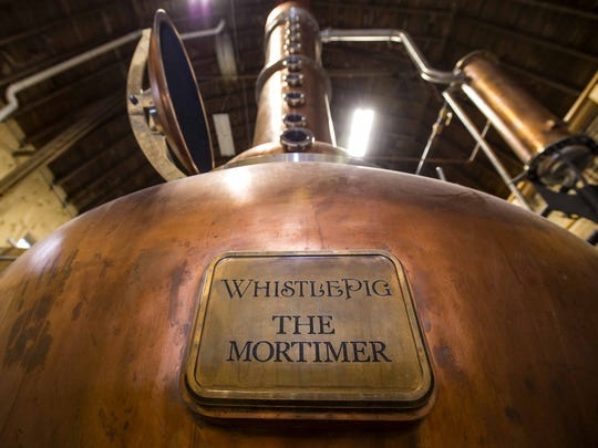 Raj Peter Bhakta has renovated a 100-year-old barn in Shoreham, transforming it into a distillery for WhistlePig rye whiskey. He named the still after Mortimer, WhistlePig's late porcine mascot.