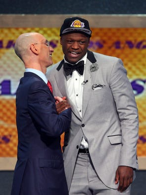 Jun 26, 2014; Brooklyn, NY, USA; Julius Randle (Kentucky) shakes hands with NBA commissioner Adam Silver after being selected as the number seven overall pick to the Los Angeles Lakers in the 2014 NBA Draft at the Barclays Center. Mandatory Credit: Brad Penner-USA TODAY Sports