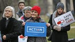 People listen to speakers at the Save My Care Bus Tour healthcare rally at the Statehouse. The two-month nationwide bus tour, which is making stops across the US, protests efforts by Congressional Republicans and President Donald Trump to repeal the Affordable Care Act.