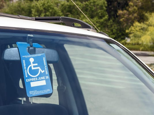 Disabled person parking blue and white permit placard