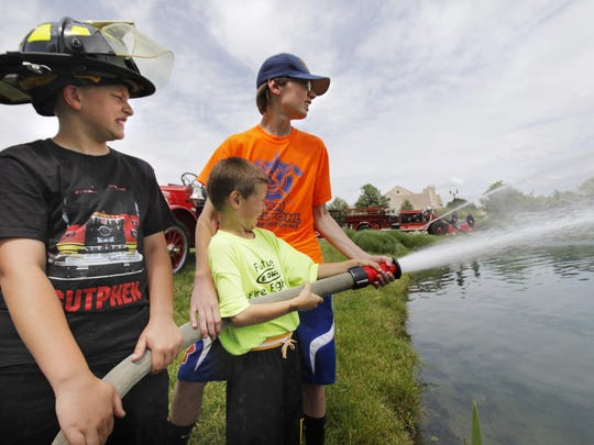 Kids can put out simulated fire with a hose and see
