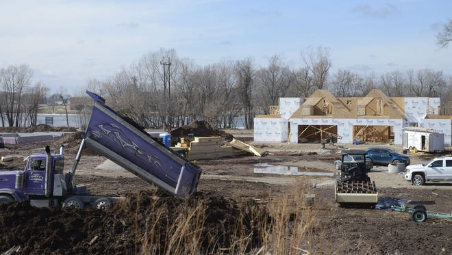 The first building in the Pelican Landing Condominium project, 1015 N. Broadway, De Pere, begins to take shape along the Fox River.