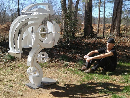 "David Sheldon with his sculpture ""Cygnus."""