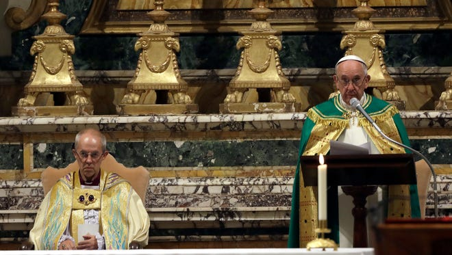 Pope Francis, right, and the Archbishop of Canterbury, Justin Welby, attend vespers prayers in the church of San Gregorio al Celio, in Rome, Wednesday, Oct. 5, 2016. (AP Photo/Gregorio Borgia)