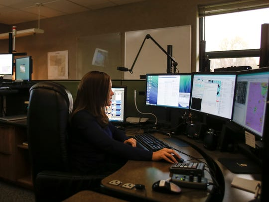 Eaton County 911 dispatcher Cassandra Yarger works