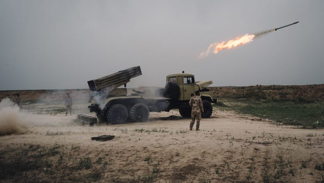 In this March 25, 2016 file photo, a rocket is fired from a rocket launcher outside Makhmour, about 47 miles east of Mosul, Iraq. Two years ago, just weeks after the fall of Mosul, an Islamic State group push deeper into Iraq''s Kurdistan region triggered Iraq''s Peshmerga forces to retreat and the U.S.-led coalition to drop the first airstrikes in the fight against the militant group. Since then coalition planes have dropped more than 9,400 bombs on Iraq.