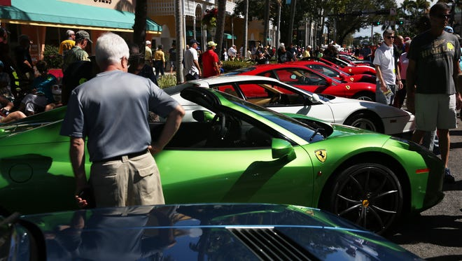 People fill Fifth Avenue South during the 12th Annual Cars on Fifth show in Naples on Saturday, Feb. 13, 2016. The show is hosted by the Naples chapter of the Ferrari Club of America.