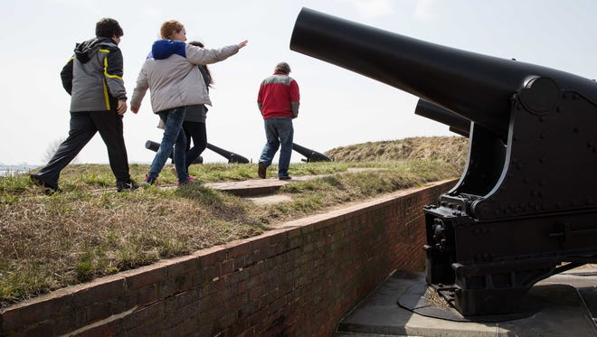A family walks by one of many cannons on display at Fort McHenry in Baltimore. Several of the batteries were part of the Battle of Baltimore, where the British Navy attacked the Baltimore Harbor.
