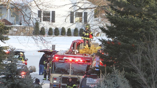 Firefighters on the scene of a fire at the home of former President Bill Clinton and Hillary Clinton on Old House Lane in Chappaqua, Wednesday, Jan. 3, 2018.