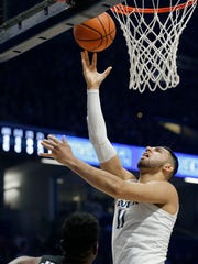Xavier Musketeers forward Kerem Kanter (11) rolls in a layup in the first half of the NCAA Big East game between the Xavier Musketeers and the Providence Friars at the Cintas Center in Cincinnati on Wednesday, Feb. 28, 2018. At halftime Xavier led 40-37.