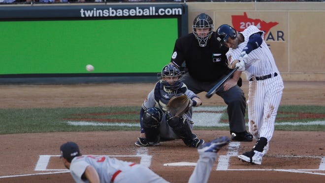 The Yankees' Derek Jeter doubles in the first inning of the MLB All-Star Game on Tuesday, in Minneapolis.