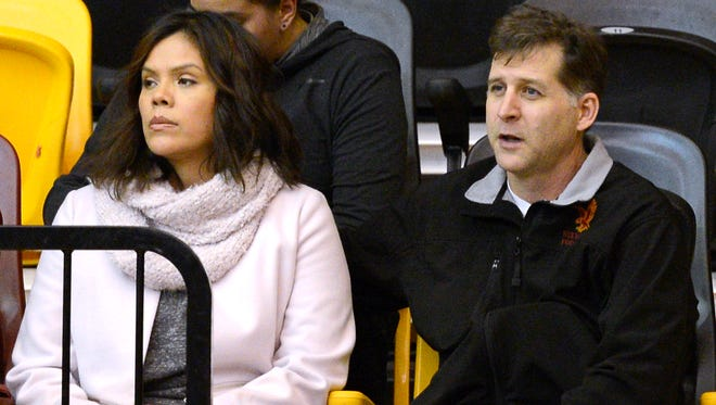 From left, Santa Fe Indian School's former head boys basketball coach Ceci Moses and her husband, Rick Schimmel, attend the school's boys basketball game Tuesday, Feb. 23, 2016, in the Pueblo Pavilion at Santa Fe Indian School in Santa Fe, New Mexico.