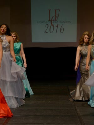 Gowns adorned the stage at the 2016 Lights Camera Fashion Show on Saturday at the Carl Perkins Civic Center.