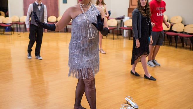 Paige Andrepont, 15, attempts a Charleston dance during a dance lesson during the Early College Academy's Roaring 20's Symposium at South Louisiana Community College in Lafayette, La., Friday, Oct. 23, 2015.