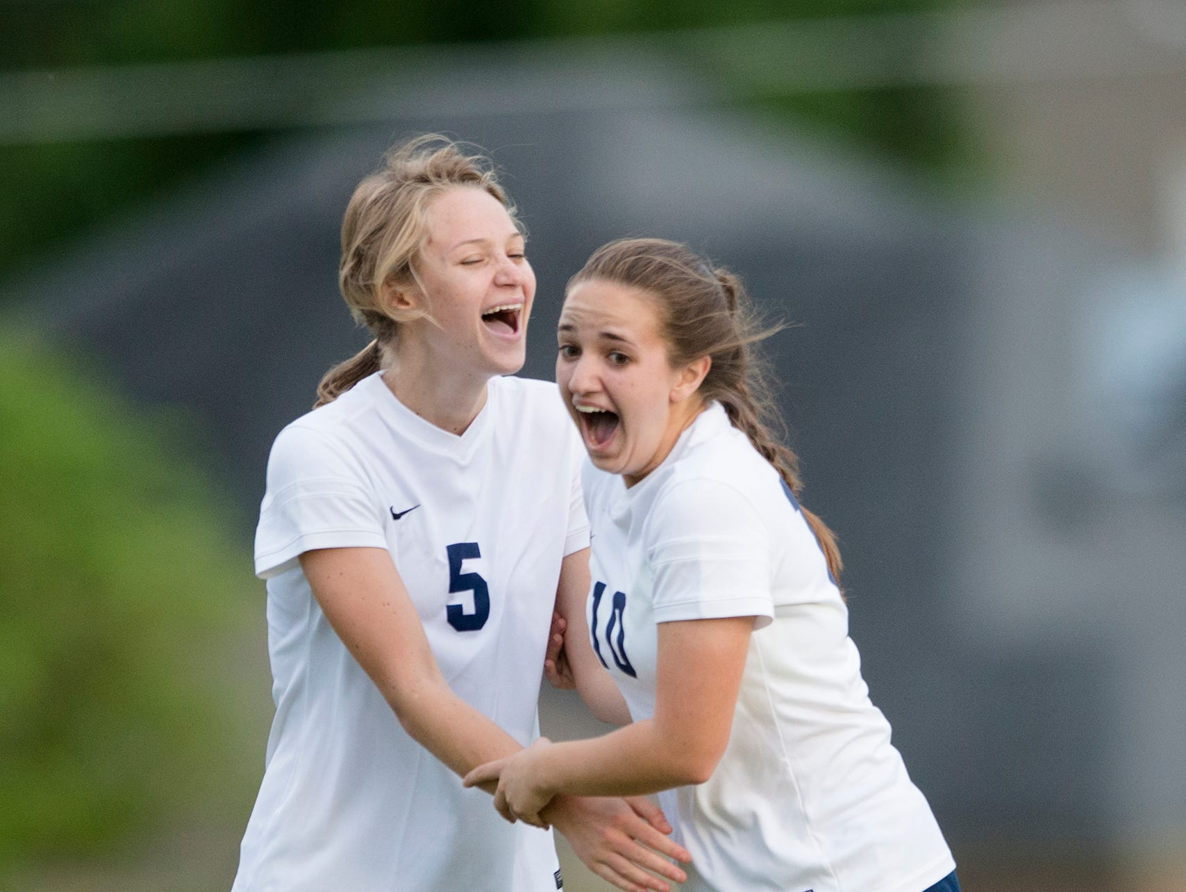 Brooke Engles (10) and Tessa Evans (5) of St. James celebrate after Engles scored a goal off a free kick about 40 yards out during the AHSAA Class 4A-5A playoff match against LAMP on Friday.