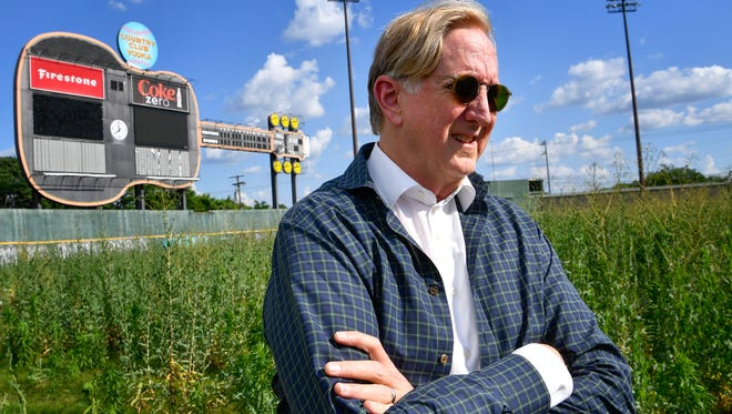 """Music producer T Bone Burnett stands June 13 in the outfield of the old Sounds stadium, where he had proposed an """"arts and music generator"""" as part of a mixed-use development at the site. The Cloud Hill team withdrew its proposal Friday."""