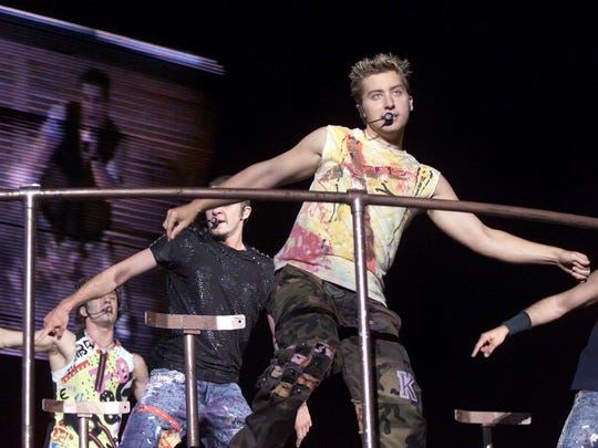 'N Sync members (from left) JC Chasez, Justin Timberlake and Lance Bass perform at the RCA Dome in 2001.