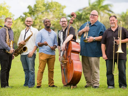 Dan Heck, center with bass, has put together his own