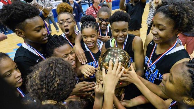 Murrah players celebrate with their trophy following the victory over Callaway during the Girls MHSAA 6A Championship game at the Mississippi Coliseum in Jackson held Thursday March 12, 2016.