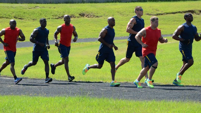 Mississippi Highway Patrol officers run laps during a workout session at the Mississippi Law Enforcement Officers Training Academy in Pearl, Ms on Wednesday, July 1, 2015. The officers are members of the MHP's LawFit Challenge team and are training for national fitness competition later this month.