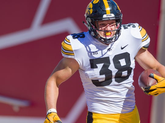 Iowa tight end T.J. Hockenson (38) rushes the ball into the end zone to score during the second half of an NCAA college football game against Indiana Saturday, Oct. 13, 2018, in Bloomington, Ind. Iowa won 42-16.