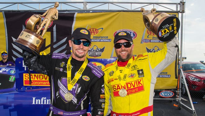 Funny car driver Jack Beckman, left, and Top Fuel driver Shawn Langdon celebrate after winning the NHRA  Midwest Nationals at Gateway Motorsports Park.
