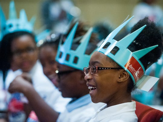 Children take part in a graduation ceremony for Montgomery