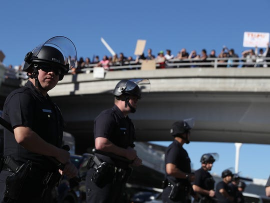 Los Angeles police officers monitor protesters during