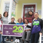 Volunteers from the Berkshire Hathaway HomeServices Fox & Roach office in Princeton painted and planted at Princeton Nursery School on Oct. 1.