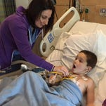 Carson Woomer, 4 at the time, is checked by a doctor at Valley Children's Hospital after open-heart surgery in fall of 2014.