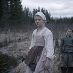 """Thomasin (Anya Taylor-Joy, left, with Harvey Scrimshaw) and her family are confronted by evil in """"The Witch."""""""