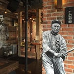 The new Rusted Crow bar in the Kales Building in Detroit is decorated with paintings of famous men like Ty Cobb.