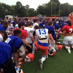 Louisiana College football players take a knee at Wednesday's practice.
