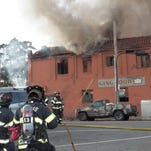 Three-alarm fire guts Chinatown building