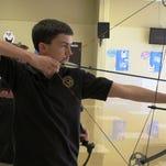 Calvary freshman Grant Schwiegeraht lines up a shot in practice.