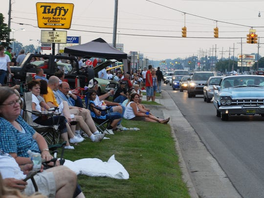 Car fans line 24th Avenue in Fort Gratiot during the 2013 Cruise Night.