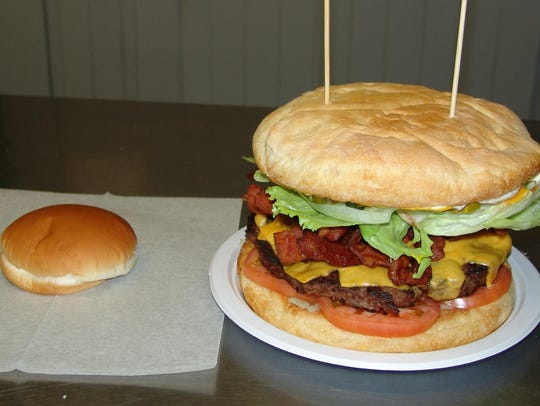 A regular-sized bun sits next to the giant Kraken Burger