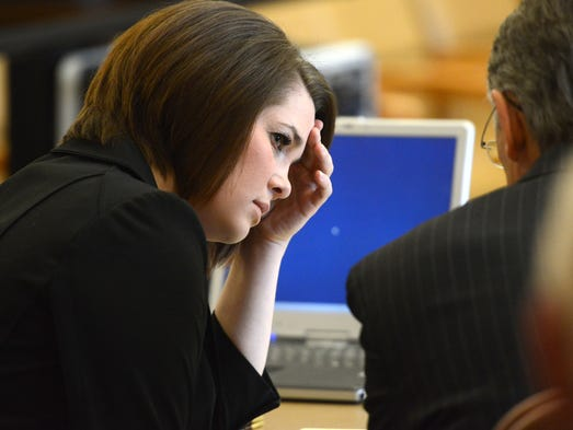 Theresa O'Connor,left, confers with her attorney, Brad Allen after she was sentenced to one year of jail time Wednesday July 2, 2014, for the death of Ernesto Wiedenbrug, after hitting him with her car while he was riding his bike in January.