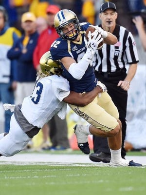 Montana State receiver Mitchell Herbert tries to shake a Fort Lewis College tackler during the first half of the Bobcats' opener Thursday night in Bozeman.