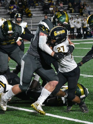 St. Amant's Lathan Vaughn is stopped by Captain Shreve's Geron Hargon in their first round playoff game Friday at Shreveport's Lee Hedges Stadium.