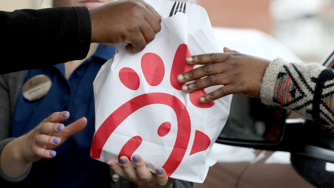 Orders seem to fly out of the drive-thru window during the opening of Chick-fil-A.