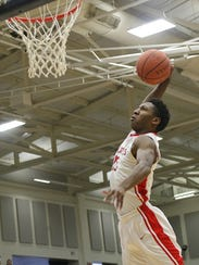 Damani Mcentire dunks the ball during the Wildcats