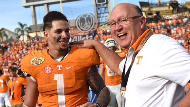 Tennessee running back Jalen Hurd (1) and Tennessee offensive coordinator Mike DeBord share a laugh following their 45-6 win over Northwestern in the Outback Bowl  on Friday, Jan. 1, 2016, at Raymond James Stadium in Tampa, Fla.