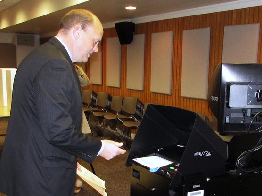 U.S. Rep. Tom Reed, R-Corning, submits his ballot