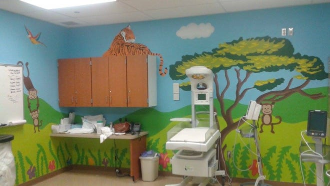 Art students at El Dorado High school painted the couplet baby room at the Hospitals of Providence East Campus.
