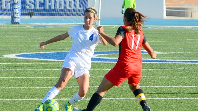 Carlsbad's Ashtin Rhoades starts dribbling slightly left against Roswell's Viri Campas in the first half Thursday.