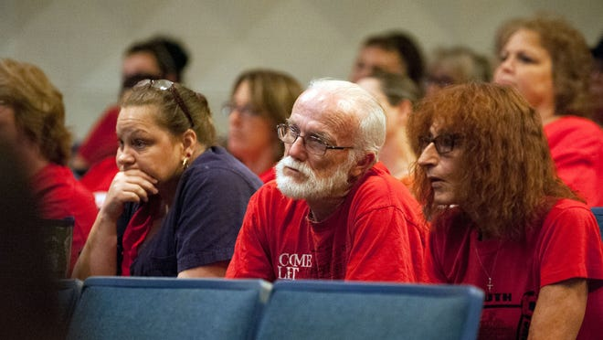 Lamora Park Elementary supporters listen as the votes are cast to determine whether Lamora Park will close