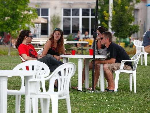 Hundreds of patrons came out to Muncie RibFest 2014 for food, fun and music on Saturday at Canan Commons in downtown Muncie. Two stages held live music performances while dozen of vendors sold ribs and other food along the street.