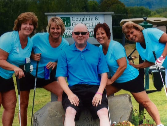 Donna Barker, far right, had a love for golfing.